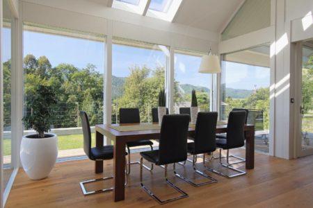 Modernes Fachwerkhaus, Holzglashaus KAGER Glasskeletthaus Designhaus